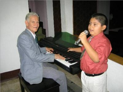 Sergio Joseph Spino singing, and Edgar Madrid playing.